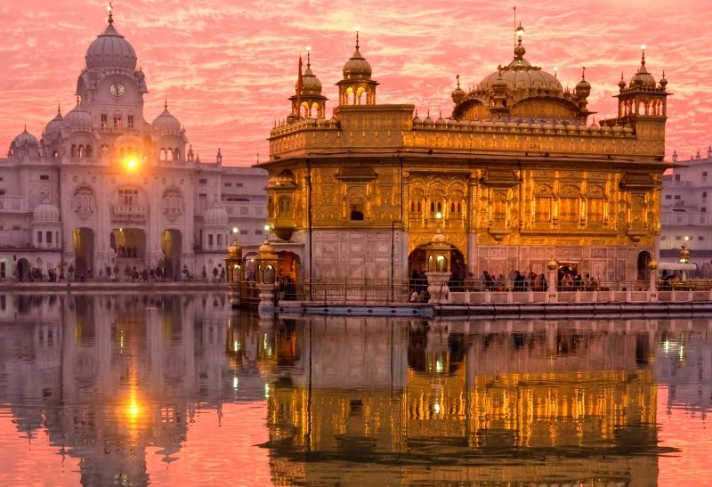 Golden temple in India reflected in the water