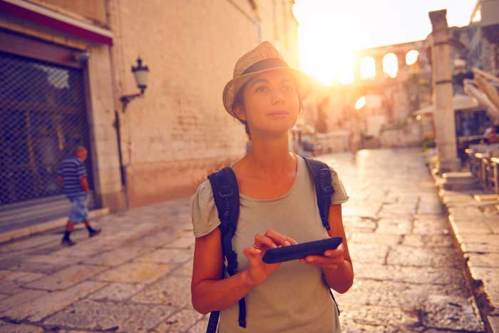 Girl travelling with her phone