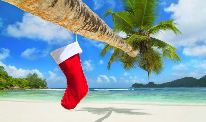 Christmas presents and stocking on the beach