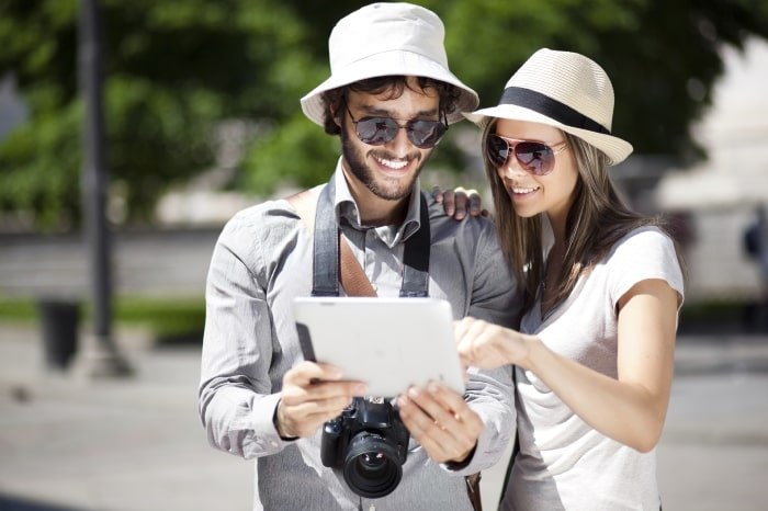 Couple with tablet travelling