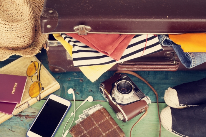 Suitcase and travel essentials