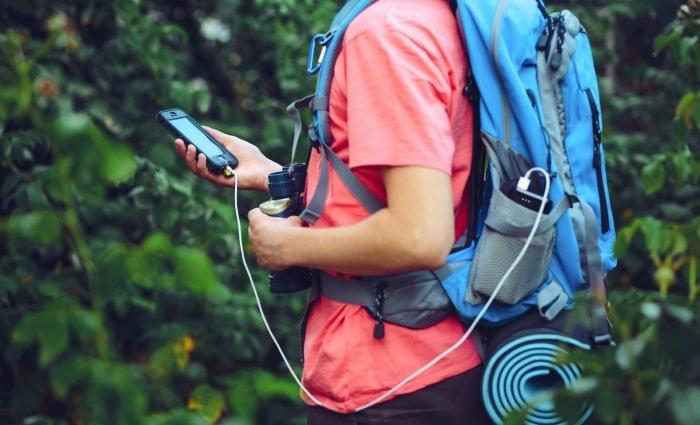Man travelling with a powerbank to charge his phone